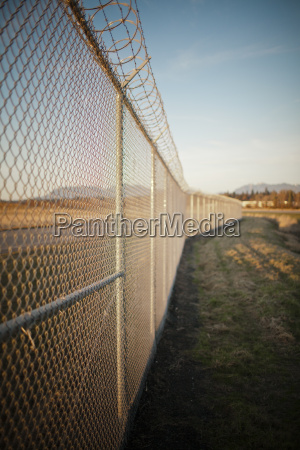 chain linked fence with a barbed