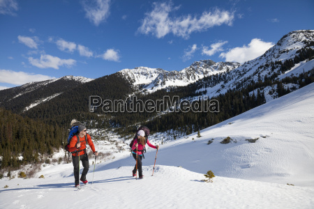 a young active couple hiking on