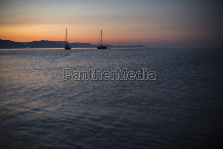 sailboats at sunrise in cala goloritze