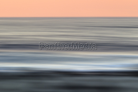 blurred ocean at sunset