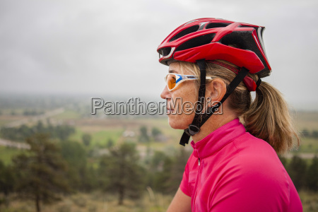women road cyclist rides a road