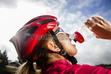 women road cyclist takes a break