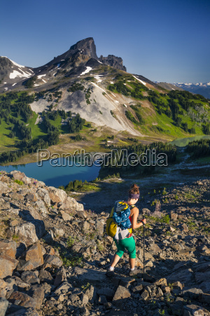 a young woman backpacking on the