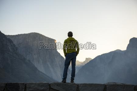 man looking at yosemite valley at
