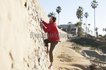 a man in his twenties climbing