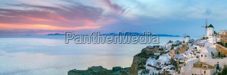 panorama of oia at sunset santorini