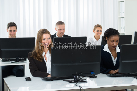 businesspeople working on computers