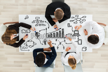 businesspeople making various business chart