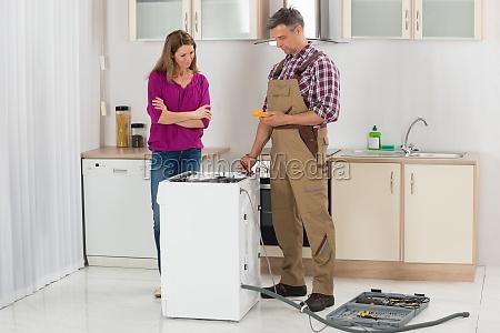 technician checking washing machine