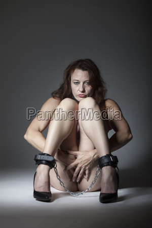 tied woman on the floor