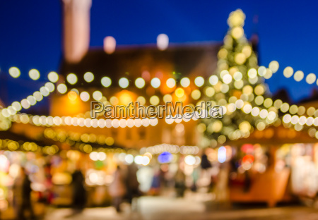 decorated christmas market abstract blurred lights