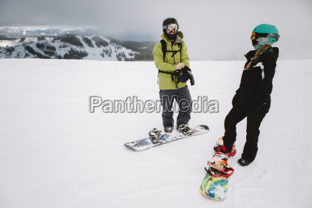 a couple snowboarding in lake tahoe