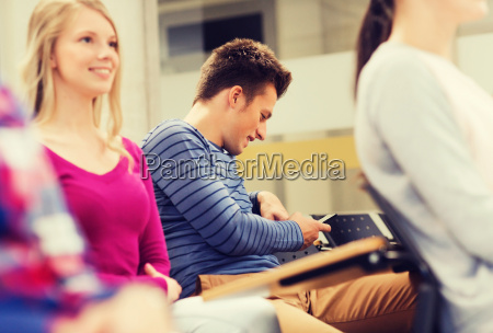 group of smiling students in lecture