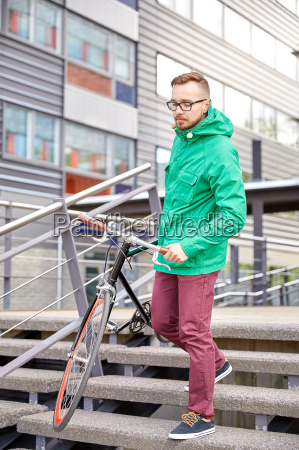 young hipster man carrying fixed gear