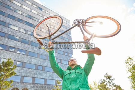young hipster man rising fixed gear