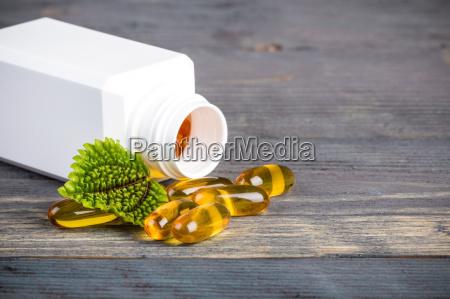 alternative medicine in plastic container