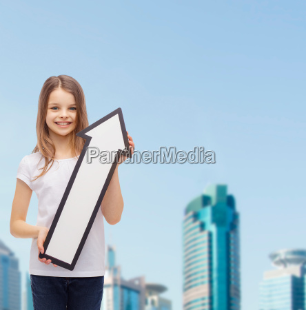 smiling little girl with blank arrow