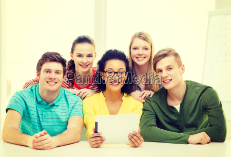 smiling students with tablet pc computer