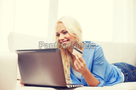 smiling woman with laptop computer and
