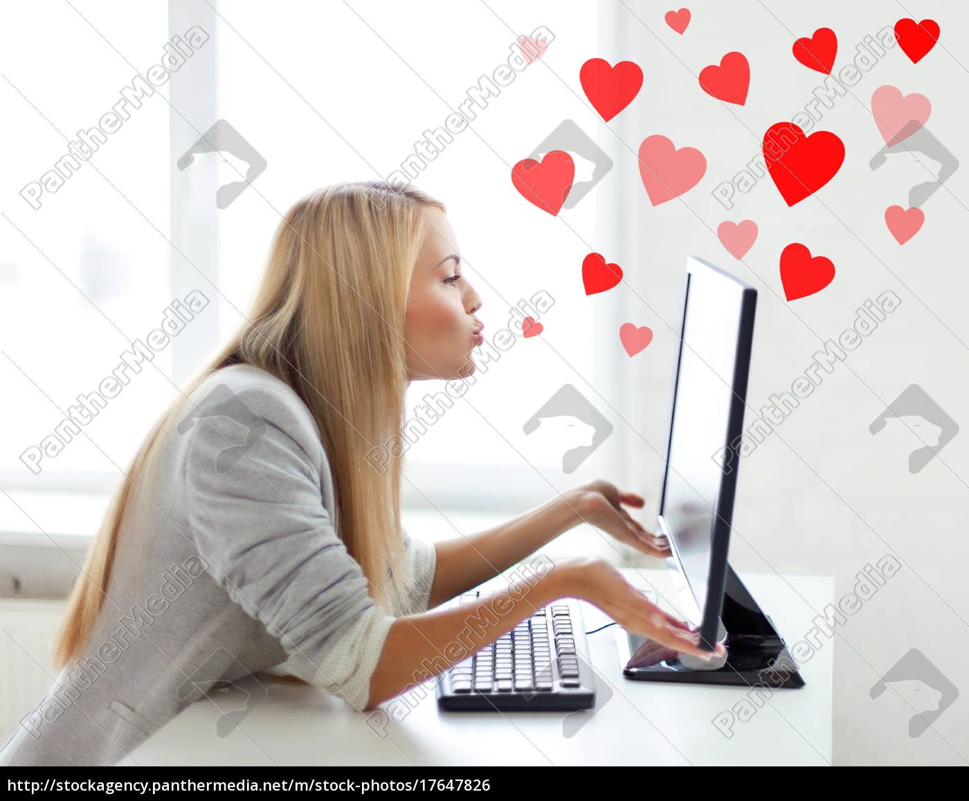 woman, sending, kisses, with, computer, monitor - 17647826