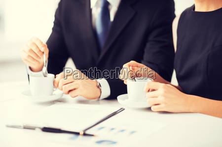 woman hand signing contract paper
