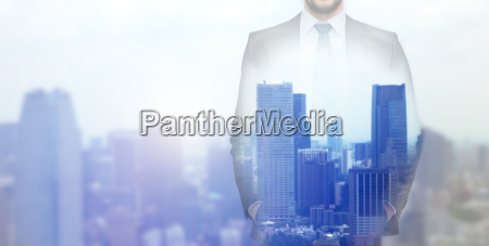 close up of businessman over city