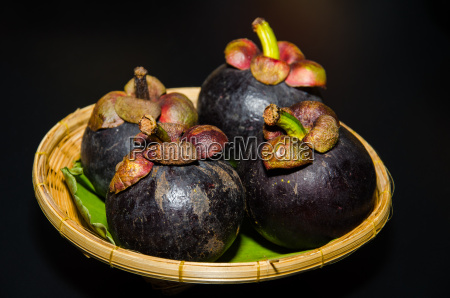 mangosteen have purple skin and white