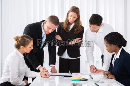 businesspeople analyzing graph