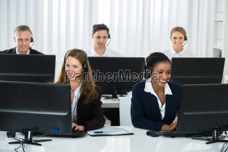 team of businesspeople working in call