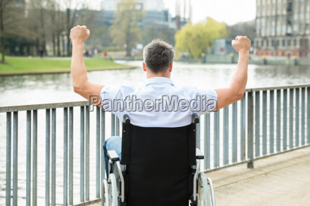 disabled man on wheelchair with hand
