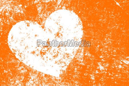 grunge white heart on orange background
