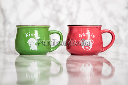 colorful ceramic mugs with enamel look