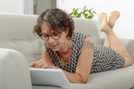 beautiful mature woman with a tablet