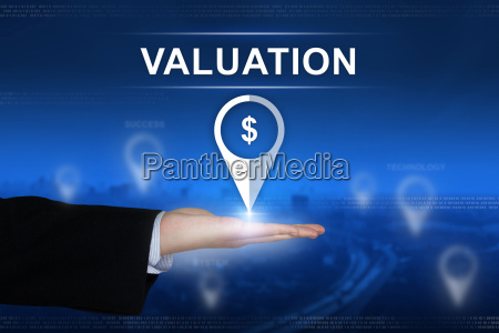 financial valuation button on blurred background