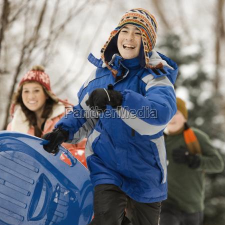 winter snow three children running carrying