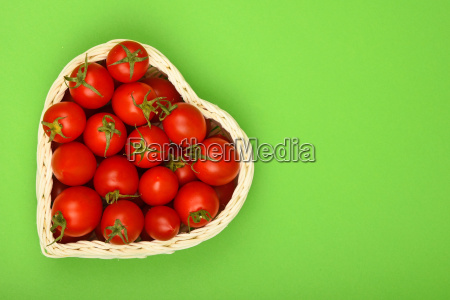 cherry tomatoes in heart shaped basket