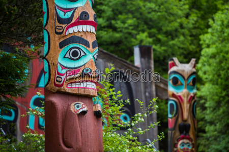 totem poles near saxman tribal house
