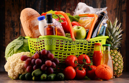 plastic shopping basket with assorted gorcery