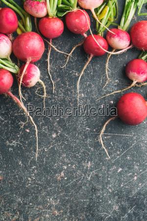 fresh radishes on old kitchen table