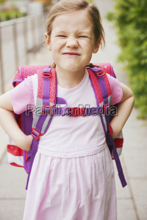 5 year old schoolgirl with pink