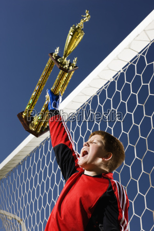 a goal keeper a boy in