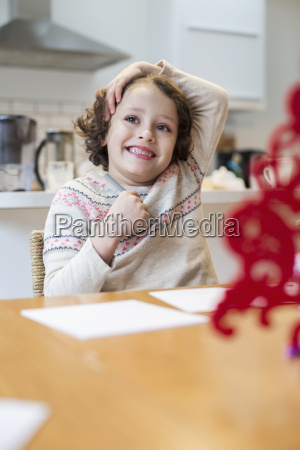 a child a girl sitting at