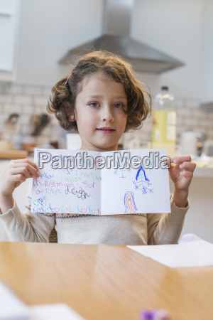 a girl showing her home made