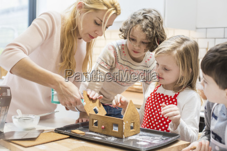 a woman and three children creating