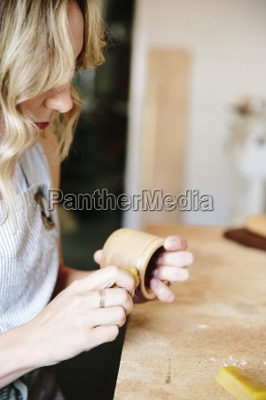 a woman in a workshop using