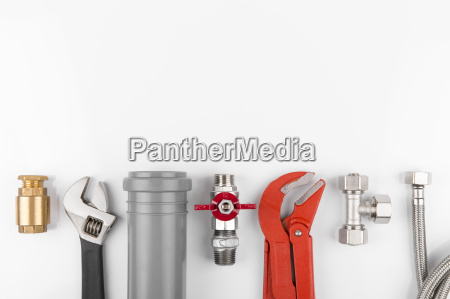 plumbing tools and equipment on white
