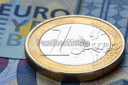 euro coin on twenty euro notes