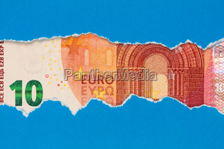 ten euro in torn paper frame