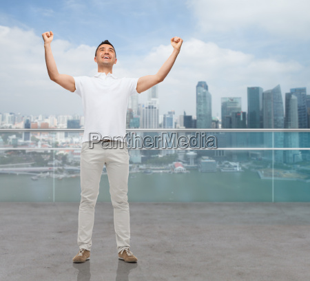 happy man with raised hands