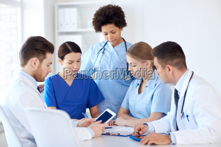 group of doctors with tablet pc
